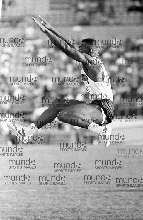 (Montreal, Canada --- 25 July 1991) Glenroy Gilbert in the long jump at the 1991 Canadian National Track and Field Championships held at the Complexe sportif Claude-Robillard in Montreal. Photo 1991 Copyright Sean Burges / Mundo Sport Images. ******This is an unprocessed scan from the negative. You can buy it as is and clean it up yourself, or contact us for rates on providing the service for you. *******