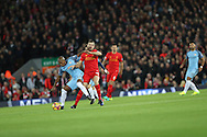 Raheem Sterling of Manchester City and Roberto Firmino of Liverpool during the English Premier League match at Anfield Stadium, Liverpool. Picture date: December 31st, 2016. Photo credit should read: Lynne Cameron/Sportimage