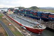 Miaflores Lock, Panama Canal, Panama, April 2014, sequence showing cargo tanker going through lock, 1 of 13 In the Miraflores locks, vessels are lifted (or lowered) 54 feet (16.5 m) in two stages, allowing them to transit to or from the Pacific Ocean port of Balboa in Panama City. Ships cross below the Bridge of the Americas, which connects North and South America.