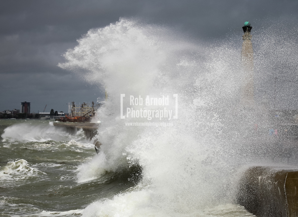 © Rob Arnold.  10/08/2014. Hampshire, UK. Large waves crash into the seafront at Southsea in Hampshire as strong winds from Ex-Hurricane Bertha batter the south coast of England. Photo by Rob Arnold