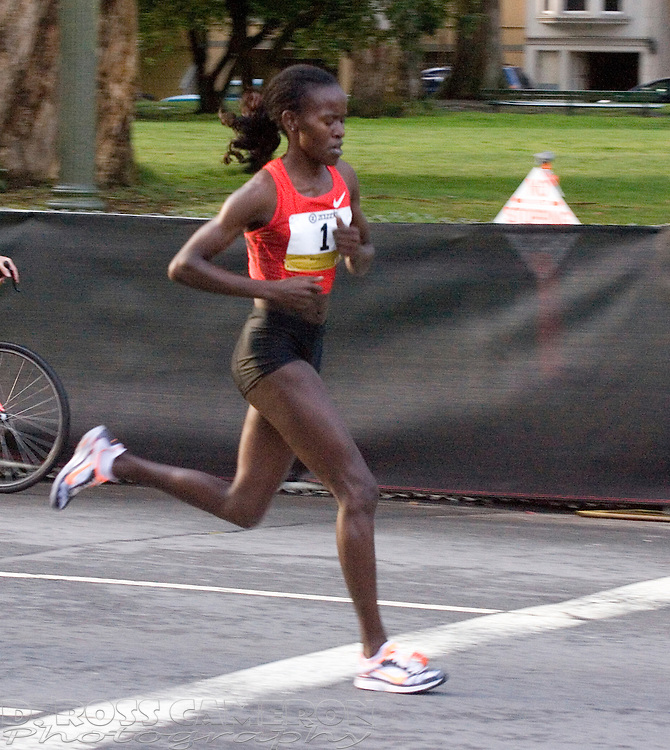 Women's winner Lineth Chepkurui of Kenya streaks along Fell Street on her way to victory in the 100th running of the Bay to Breakers 12K through San Francisco, Sunday, May 15, 2011. Chepkurui posted a winning time of 39:11. ((Photo by D. Ross Cameron)