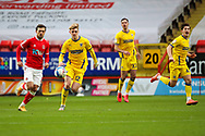 AFC Wimbledon midfielder Jack Rudoni (12) chasing through ball during the EFL Sky Bet League 1 match between Charlton Athletic and AFC Wimbledon at The Valley, London, England on 12 December 2020.