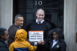 """© Licensed to London News Pictures. 29/11/2016. London, UK. The family of British man Andargachew """"Andy"""" Tsege, who is in his sixties, bring a petition to Downing Street calling on the Prime Minister to seek his release, whilst he is in prison in Ethiopia under the shadow of a death sentence. Andargachew Tsegehas been detained in the country since he was removed from an airport in Yemen in June 2014. The father-of-three, who fled the country in the 1970s and sought asylum in the UK in 1979, had been a prominent critic of Ethiopia's ruling party. Photo credit : Tom Nicholson/LNP"""
