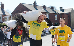 © Licensed to London News Pictures. 06/04/2015. Gawthorpe, UK. Competitor John Gibbons finishes the race after falling as he approached the finish line during the World Coal Carrying Championships, Gawthorpe, West Yorkshire. Photo credit : Anna Gowthorpe/LNP