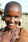Africa, Tanzania, female members of the Datoga tribe Woman in traditional dress, beads and earrings. Beauty scarring can be seen around the eyes, April 2008