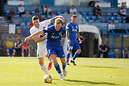 Cove Rangers' Ian Vigurs (16) and Peterhead's Hamish Ritchie (7) battles for possession, tussles, tackles, challenges, during the Premier Sports Scottish League Cup match between Peterhead and Cove Rangers at Balmoor, Peterhead, Scotland on 17 July 2021.