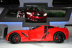 "08  February 2013: 2014 Chevrolet Corvette Stingray sports car. Chicago Auto Show, Chicago Automobile Trade Association (CATA), McCormick Place, Chicago Illinois<br /> <br /> 2014 CHEVROLET CORVETTE STINGRAY: Crowds will be swarming to the Chevrolet exhibit during the ten-day run of the 2013 Chicago Auto Show to be among the first to see the 2014 Corvette on display. Visually stunning, the '14 Corvette's sculptured, aerodynamic two-door hatchback exterior and track-capabilities is worthy of the iconic ""Stingray"" designation. This marks the seventh-generation of ""America's Sport Car,"" and as the C7, goes farther than ever, thanks to today's advancements in design, technology and engineering. Matching the dramatic exterior is a new 6.2 liter (376 cubic inch) LT1 V-8 engine that pumps out 450 horsepower and 450 lb.-ft. of torque to the rear wheels. Consumers have their choice of a six-speed paddle-shift automatic or seven-speed manual gearbox with ""Active Rev Match"" that anticipates gear selections and matches engine speed for perfect shifts every time. Either way, we're talking 0-to-60 mph in less than four seconds. For 2014, the latest Corvette shares only two parts with the previous generation model. Underneath is an all-new frame structure and chassis that helped shift weight rearward for an optimal 50/50 weight balance. Lightweight features include a carbon fiber hood and removable roof panel; composite fenders, doors and rear quarter panels. Slide into the cockpit composed of premium materials, smaller-diameter steering wheel, standard dual, eight-inch configurable driver/infotainment screens and available color head-up display. There are two new seat choices - each featuring a lightweight magnesium frame. You can see the 2014 Corvette Stingray coupe in Chicago from Feb. 9th-18th, or wait until they roll into Chevrolet dealerships the third quarter of 2013."