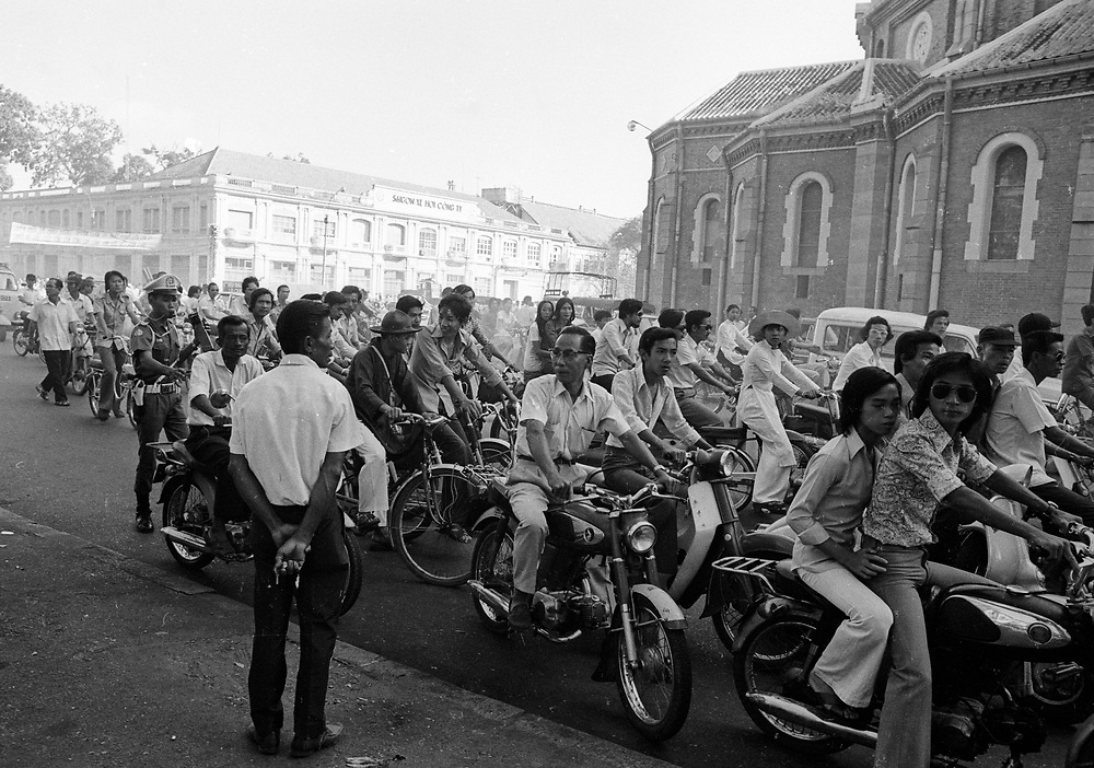 Crowded streets in Saigon as the North Vietnamese get nearer to the Capital City before the fall. April 1975. photographed by Terry Fincher