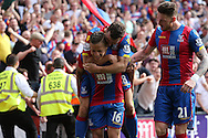 Dwight Gayle of Crystal Palace (16) celebrates with James McArthur of Crystal Palace and Connor Wickham of Crystal Palace after scoring his sides 2nd goal to make it 2-1.Barclays Premier League match, Crystal Palace v Stoke City at Selhurst Park in London on Saturday 7th May 2016. pic by John Patrick Fletcher, Andrew Orchard sports photography.