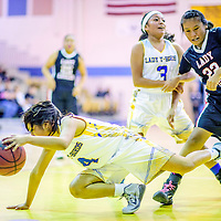 Zuni Thunderbird Alanee Esalio (4), let, tries to save her dribble at Zuni High School Tuesday.