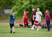 Kris Cullen of Woodland Heights School throws the javelin during the 5th grade track meet at Opechee Park with Elm Street, Pleasant Street and Woodland Heights Elementary students Wednesday morning.  (Karen Bobotas/for the Laconia Daily Sun)