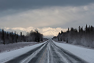 The Alaska Highway, Highway 2, leading into the town of Tok with the Alaska Range in the distance.
