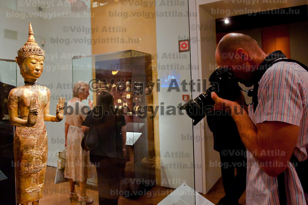 Photographer takes photos of an artifact in the Southeast Gold Museum that presents hundreds of golden artifacts from the private collection of founder Istvan Zelnik in Budapest, Hungary on September 15, 2011. ATTILA VOLGYI