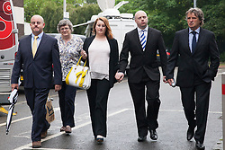 "© Licensed to London News Pictures. 14_07_2015. Solihull, West Midlands, UK. Pictured, the ROBERTS family, left and the DUNSBY family, right arrive at the final day of the inquest. The inquest into the deaths of three army reservists taking place at Solihull Council House. Edward Maher, Craig Roberts and James Dunsby died after collapsing during an SAS training exercise on the Brecon Beacons in July 2013. The soldiers, from Hampshire, North Wales and Wiltshire, all suffered heatstroke during the 16-mile ""test week"" march. Photo credit : Dave Warren/LNP"