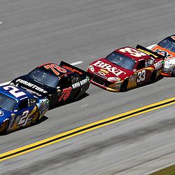 April 17, 2011; Talladega, AL, USA; NASCAR Sprint Cup Series driver Brad Keselowski (2) leads Regan Smith (78), Clint Bowyer (33) and Michael Waltrip (15) during the Aarons 499 at Talladega Superspeedway.   Mandatory Credit: Derick E. Hingle