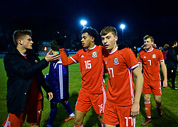 BANGOR, WALES - Tuesday, November 20, 2018: Wales' players Jack Vale, Brennan Johnson and Joseph Adams celebrate after a 2-0 victory over San Marino and qualification into the Elite Round after the UEFA Under-19 Championship 2019 Qualifying Group 4 match between Wales and San Marino at the Nantporth Stadium. (Pic by Paul Greenwood/Propaganda)