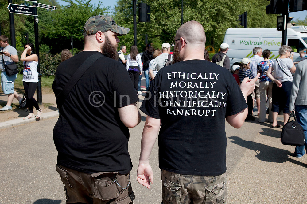 Man wearing an amusing t-shirt which says: 'Ethically Morally Historically Scientifically Bankrupt'.