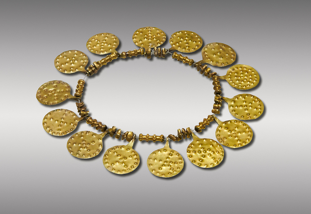 Bronze Age Hattian gold necklace from Grave E,  possibly a Bronze Age Royal grave (2500 BC to 2250 BC) - Alacahoyuk - Museum of Anatolian Civilisations, Ankara, Turkey. Against a gray background .<br /> <br /> If you prefer to buy from our ALAMY PHOTO LIBRARY  Collection visit : https://www.alamy.com/portfolio/paul-williams-funkystock/royal-tombs-alaca-hoyuk-bronze-age.html (TIP refine search by adding background colour in the LOWER search box)<br /> <br /> Visit our ANCIENT WORLD PHOTO COLLECTIONS for more photos to download or buy as wall art prints https://funkystock.photoshelter.com/gallery-collection/Ancient-World-Art-Antiquities-Historic-Sites-Pictures-Images-of/C00006u26yqSkDOM