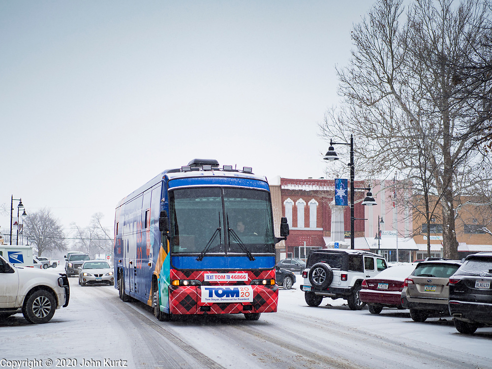 29 JANUARY 2020 - KNOXVILLE, IOWA: Tom Steyer's campaign bus drives through Knoxville before a campaign event Wednesday. About 60 people attended the campaign meet and greet. Steyer, a California businessman, is campaigning to be the Democratic nominee for the US Presidency in 2020. Iowa holds the first selection event of the 2020 election cycle. The Iowa Caucuses are Feb. 3, 2020.          PHOTO BY JACK KURTZ