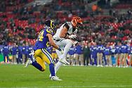 Cincinnati Bengals Tyler Eifert (85) catches the ball under pressure during the International Series match between Los Angeles Rams and Cincinnati Bengals at Wembley Stadium, London, England on 27 October 2019.