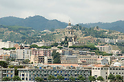the old city of Messina and the  Shrine of Cristo Re as seen from the Messina port, sicily, Italy, on a Sunday afternoon, July 2006.