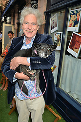 MATTHEW HORTON and Dolly Beddow at A Date With Your Dog At George in aid of the Dogs Trust held at George, 87-88 Mount Street, London on 9th September 2014.