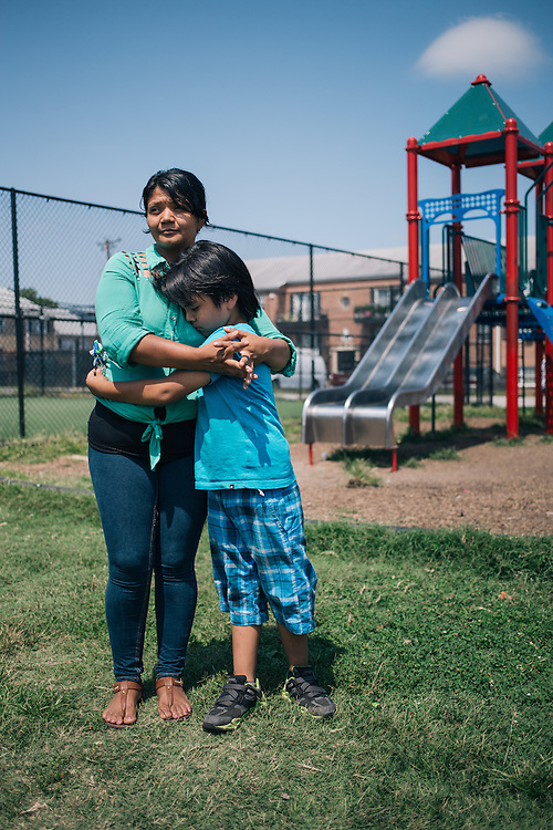 LANGLEY PARK, MARYLAND - August 20: Dilma, a Washington, D.C., resident, stands with her son Jack, 6, who suffers from autism. Dilma was recently reunited with her 12-year-old son David, after he journeyed from his home country of Honduras. Dilma had not seen David for eight years. He left Honduras after he had suffered abuse from his guardians and to flee the recruitment of gangs. DIlma is trying to get David enrolled in DC Public Schools so he can get an education.