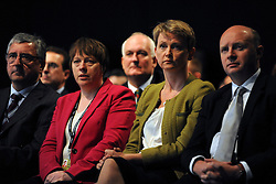 © Licensed to London News Pictures. 26/09/2011. LONDON, UK. Maria Eagle (Red coat) and Yvette Cooper (green jumper) watch Ed Balls (not pictured) deliver his speech at The Labour Party Conference in Liverpool today (26/09/11). Photo credit:  Stephen Simpson/LNP
