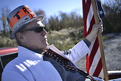 November 4, 2016 - Pennsylvania, U.S - Sitting in the back of his Ford pick-up, Larry Shaak, of Harrisburg, PA., is seen dressed up as Trumpman, as he waves to passers-by on their way to the Nov. 4, 2016 Donald Trump rally in Hershey, PA. (Credit Image: © Bastiaan Slabbers via ZUMA Wire)