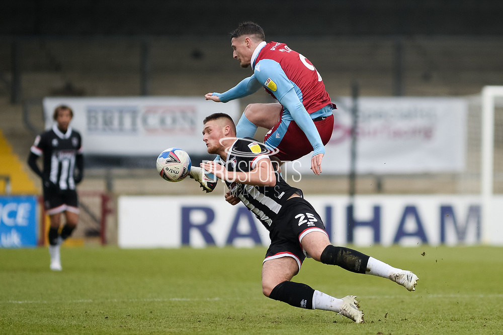 Scunthorpe United Ryan Loft (9) Grimsby Town Mattie Pollock (25) battles for possession during the EFL Sky Bet League 2 match between Scunthorpe United and Grimsby Town FC at the Sands Venue Stadium, Scunthorpe, England on 23 January 2021.