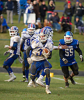 Andrew Brothers gets some yardage during Saturday's NHIAA semi final Football with Winnisquam.  (Karen Bobotas/for the Laconia Daily Sun)