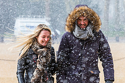 © Licensed to London News Pictures. 26/02/2018. London, UK. A couple brave the snow on Horse Guards Parade in Central London. Severe cold, blizzards and heavy snow are expected as the 'Beast from the East' brings freezing Siberian air to the UK. Photo credit: Rob Pinney/LNP