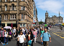 Pedestrians crossing street at Princes Street in Edinburgh, Scotland, UK