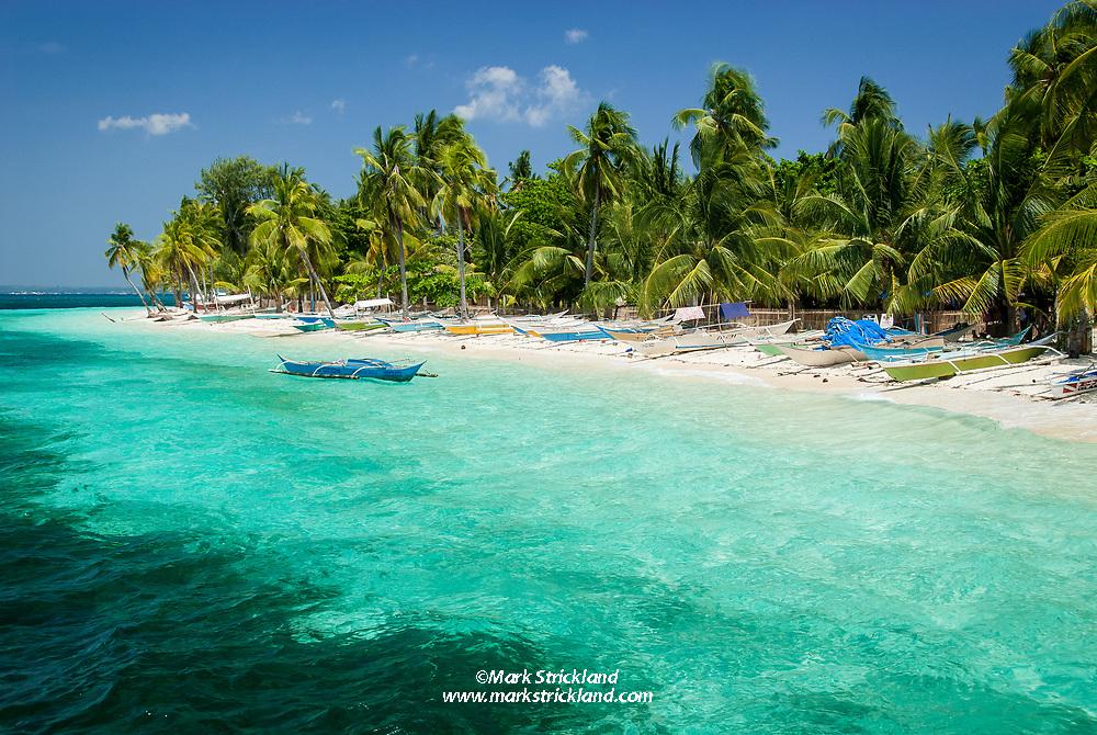 Warm, clear waters meet white sand beaches at Malapascua Island, Visayan Sea, Philippines, Pacific Ocean