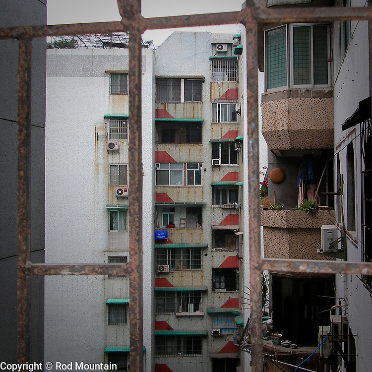 Looking out from the barred windows of an apartment in Guangzhou, China.