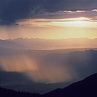 Virga falls from clouds drifting over California's eastern Sierra Nevada, viewed from the White Mountains.