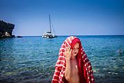Mallorca, Cala Banyalbufar, Boy in his innerworld after snorkling. 29-07-2018