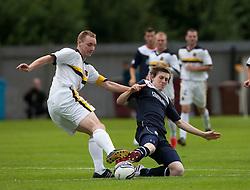 Dumbarton's Chris Turner and Falkirk's Blair Alston.<br /> half time : Dumbarton 0 v 0 Falkirk, Scottish Championship 10/8/2013.<br /> ©Michael Schofield.