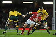 Matthew Rees of Wales is clouted by Australia no8 Wycliff Palu. Dove Men, autumn international test, Wales v Australia at the Millennium Stadium in Cardiff on Sat 1st Dec 2012. pic by Andrew Orchard, Andrew Orchard sports photography,