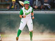 Oregon infielder Hailey Decker (14) reacts after sliding into home plate for a run during the third inning. The Oregon Ducks play the BYU Cougars during NCAA softball regionals at Howe Field in Eugene, Oregon on May 14, 2015. (Ryan Kang/Emerald)
