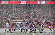 Quarterback Drew Lock #3 of the Denver Broncos drops back to pass, during a heavy snow fall, in the second half against the Kansas City Chiefs at Arrowhead Stadium on December 15, 2019 in Kansas City, Missouri.