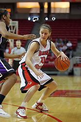 08 March 2008: Kristi Cirone backs her dribble across the 3 point line while being guarded by Ashley Austin. The University of Evansville Purple Aces and the Illinois State University Redbirds took the court looking for the MVC season title, but the Redbird win (87-72) split the title.  The game was played on Doug Collins Court in Redbird Arena in Normal Illinois.