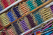 Reels of coloured sewing thread in the market of Rissani, Morocco.