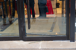© London News Pictures. 20/07/15. London, UK. The damaged doors of the Louis Vuitton store which was raided overnight, Sloane Street, Central London. Photo credit: Laura Lean/LNP