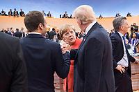 07 JUL 2017, HAMBURG/GERMANY:<br /> Emmanuel Macron (L), Praesident Frankreich, Angela Merkel (M), CDU, Bundeskanzlerin, und Donald Trump (R), Praesident Vereinigte Staatsn von America, USA, im Gesprech, vor Beginn der 1. Arbeitssitzung, G20 Gipfel, Messe<br /> IMAGE: 20170707-01-026<br /> KEYWORDS: G20 Summit, Deutschland, Gespräch, Handshake, Armdruecken, Armdrücken, Hand, Haende, Hände, schütteln, schuetteln