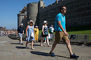 Members of the public approach Windsor Castle on Freedom Day, when the UK government lifted almost all remaining Covid-19 restrictions in England, on 19th July 2021 in Windsor, United Kingdom. Social distancing restrictions have been removed and face coverings are no longer required by law, although their use is recommended in crowded and enclosed spaces. Cases of the coronavirus are now expected to surge across the UK, which currently has the highest rate of daily recorded Covid-19 cases in the world.