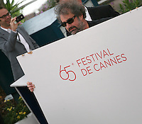 Director Gustave Kervern, with dismantled podium at Le Grand Soir photocall at the 65th Cannes Film Festival France. Tuesday 22nd May 2012 in Cannes Film Festival, France.