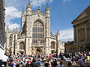 Tourists in the Abbey churchyard, Bath, Somerset, England