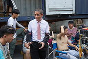GUANGZHOU, CHINA - OCTOBER 02: (CHINA OUT)<br /> <br /> Chinese Obama Imitator<br /> <br /> Xiao Jiguo who is famous for imitating American President Obama talks with other actors during a break of shooting comedy at a warehouse on October 2, 2015 in Guangzhou, China. Xiao Jiguo, born in Sichuan province, was well-known as an imitator of American President Barack Hussein Obama after acting in a Chinese entertainment program. He became a star among the commercial events and acted in a comedy during the Chinas National Day Holiday in Guangzhou.<br /> ©Exclusivepix Media