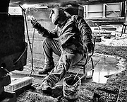 Ghent, Belgium, 6 apr 2012, Metalworker at the dry dock repairing the bottom of a ship